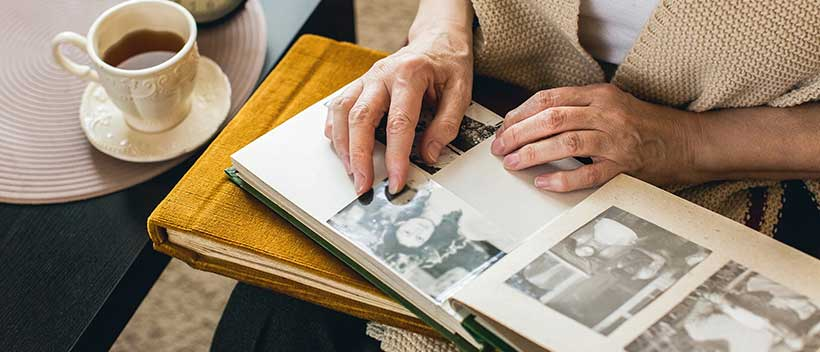 Creating and looking through scrapbooks is a great Alzheimer's activity.