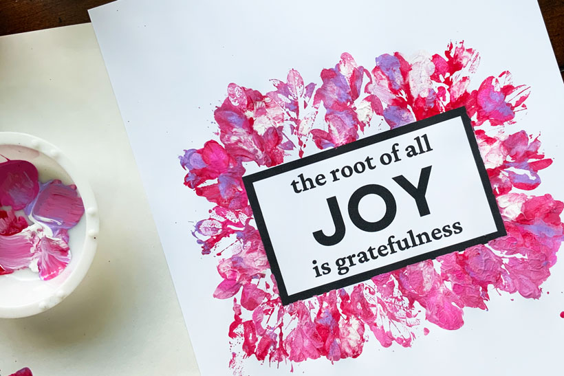 The Root of all Joy is Gratefulness quote surrounded by pink leaf prints